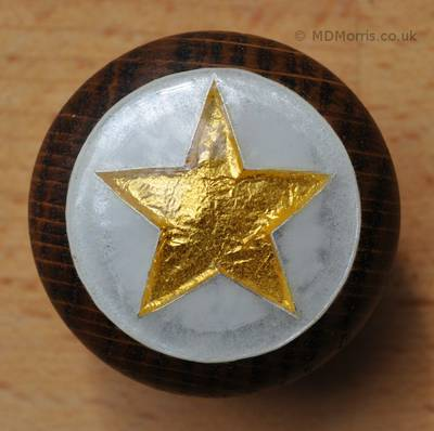 Cloisonné Enamel Doorknob showing a Gold Pret-a-Manger Star with Opal Background