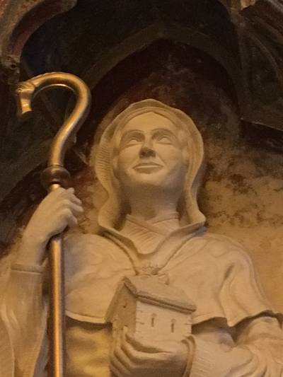 A close-up of the statue of St. Kyneburgha in Gloucester Cathedral