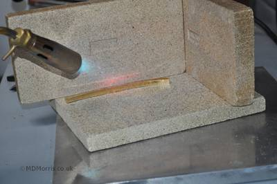 Annealing the bar with a torch