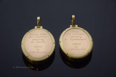 The inscription on the back of the medals