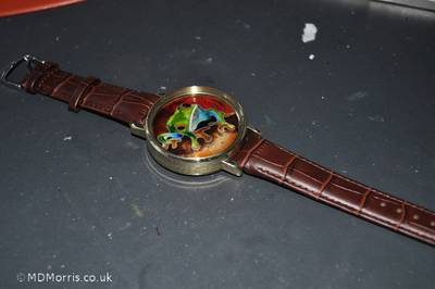 Watch constructed with strap just placed in position